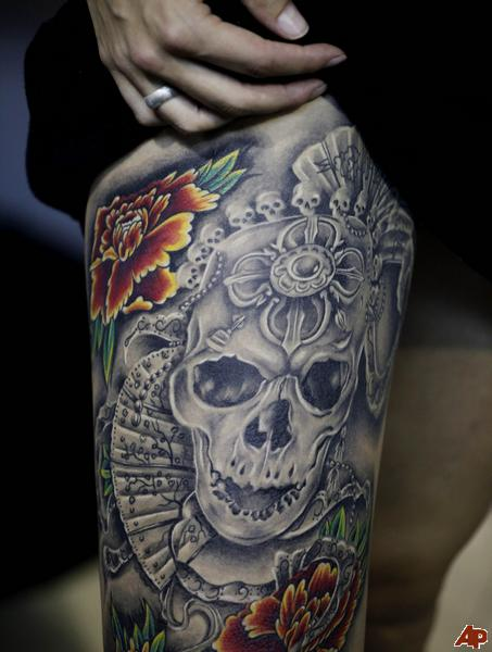 Grey Ink Mexican Skull Tattoo On Thigh