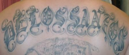 Grey Ink Mexican Tattoo On Back