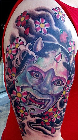 Half Sleeve Japanese Mask And Flowers Tattoo Design