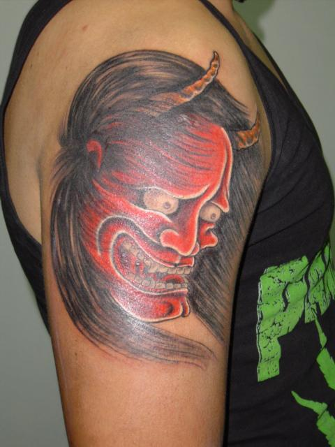 Japanese Devil Mask Tattoo On Upper Arm