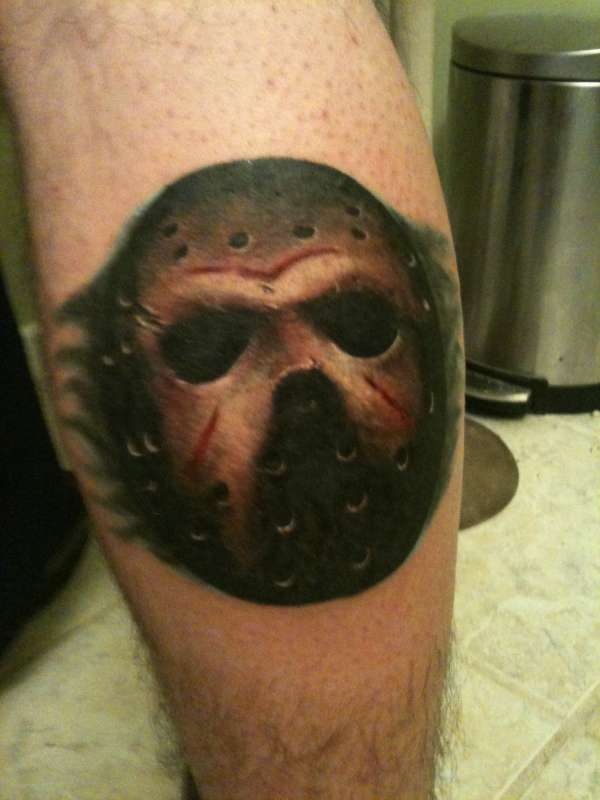 Jason Mask Tattoo On Leg