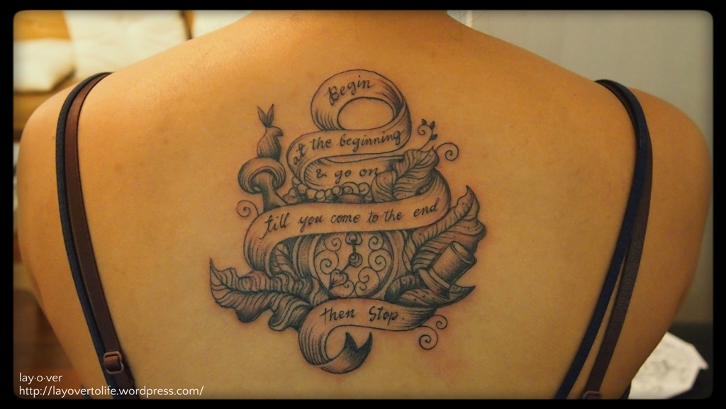 Literary Banner And Watch Tattoo On Upper Back