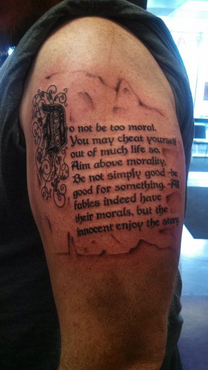 Literary Tattoo On Biceps For Men