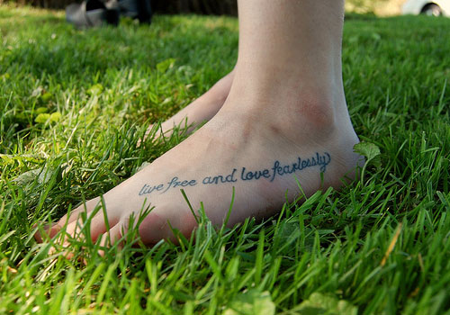 Live Free And Love Fearlessly Literary Tattoo On Foot