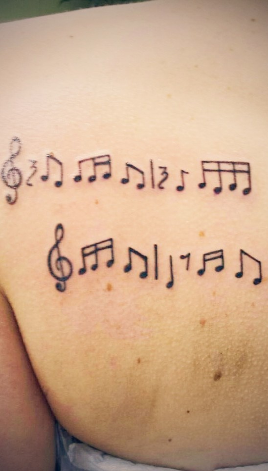 Love Music Notes Tattoo On Back