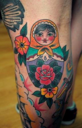 Matryoshka And Flowers Tattoo For Leg