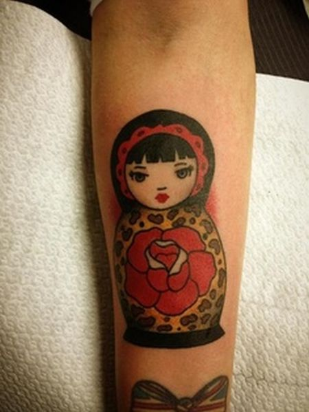 Matryoshka Doll With Rose Tattoo On Leg