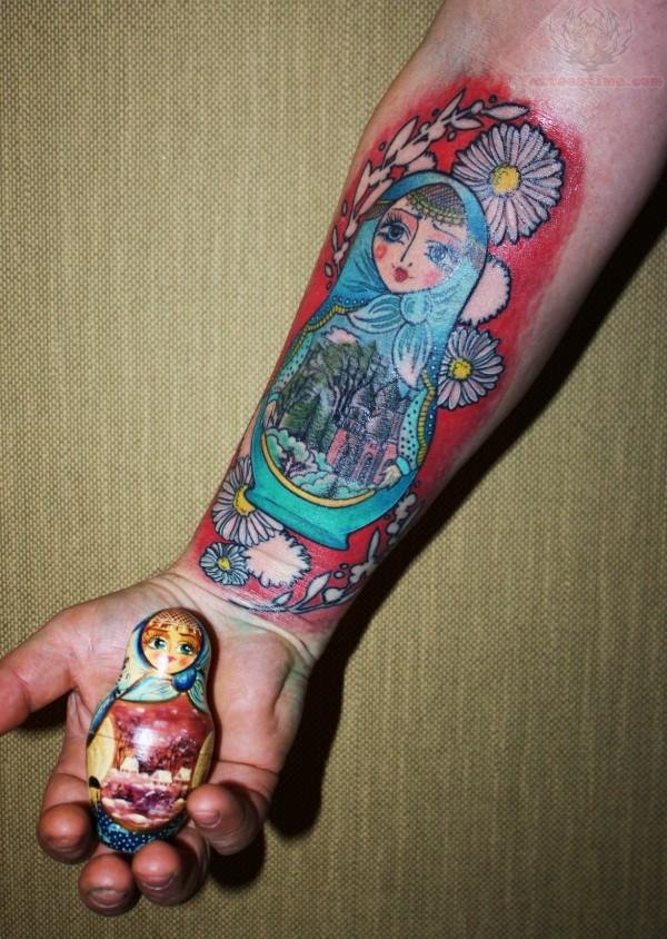 Matryoshka Tattoo And Doll In Hand