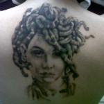 Medusa Head Tattoo On Upper Back