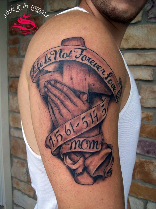 Memorial Cross And Praying Hands Tattoo On Biceps