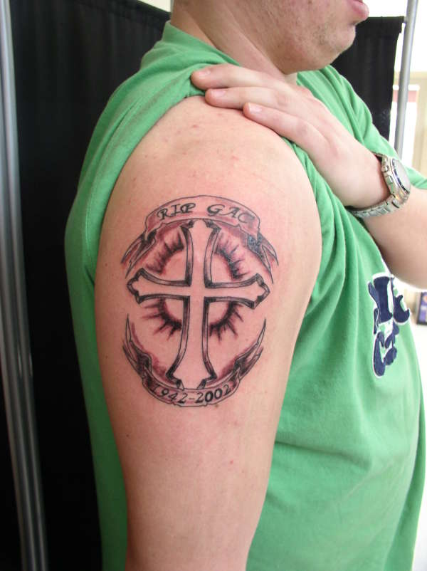 Memorial Cross Tattoo On Muscles