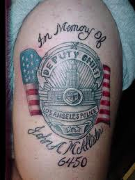 Memorial Deputy Chief Police Badge With USA Flag Tattoo On Arm