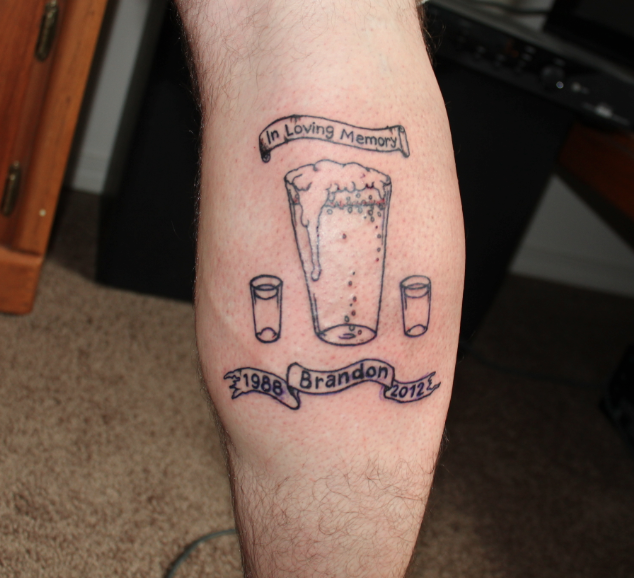 Memorial Glasses Tattoo On Leg