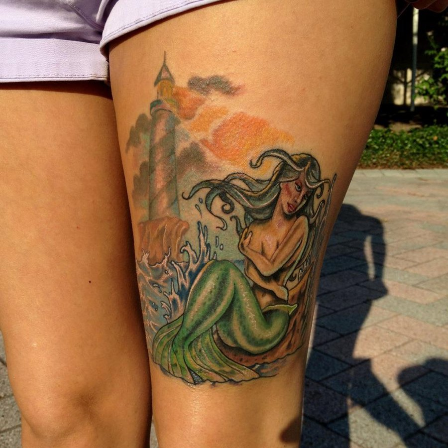 Mermaid And Lighthouse Tattoo On Thigh