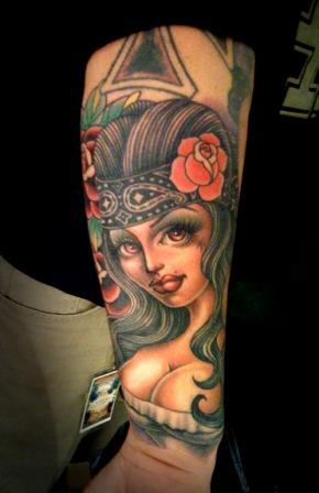 Mexican Pin Up Girl Tattoo On Lower Arm
