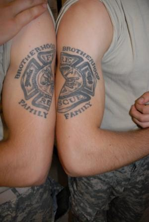 Military Fire Fighter Tattoo On Muscles