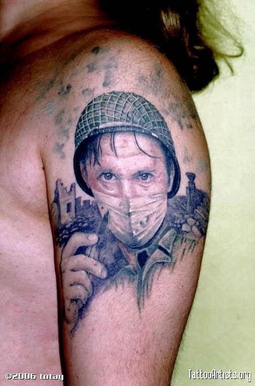 Military Man Portrait Tattoo On Biceps