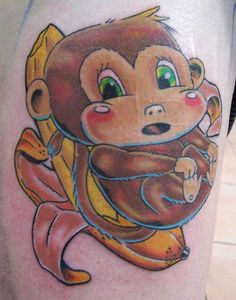 Monkey On Banana Tattoo Design