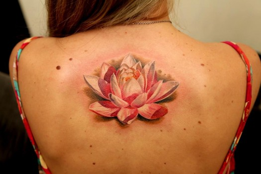 Pink And White Lotus Flower Tattoo On Upper Back