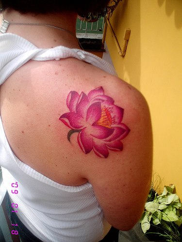 Pink Ink Lotus Flower Tattoo On Back Shoulder