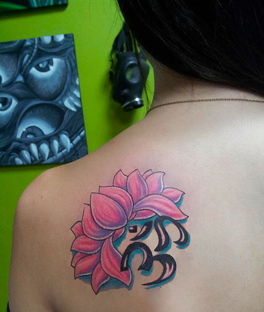Pink Lotus Flower And Om Symbol Tattoo On Back Shoulder