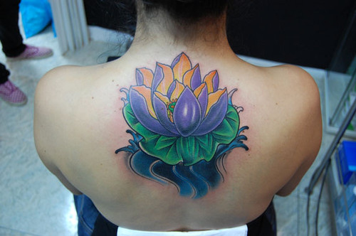 Purple Lotus Flower Tattoo On Back Neck