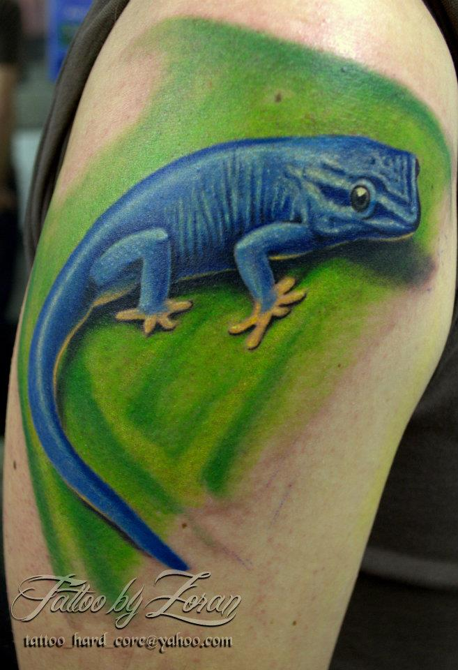 Realistic Blue Lizard Tattoo On Upper Arm