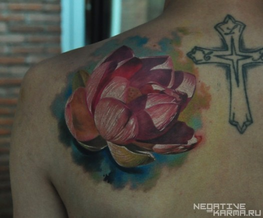 Realistic Lotus Tattoo With Cross On Back