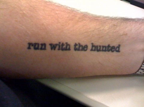 Run With The Hunted Literary Tattoo On Arm