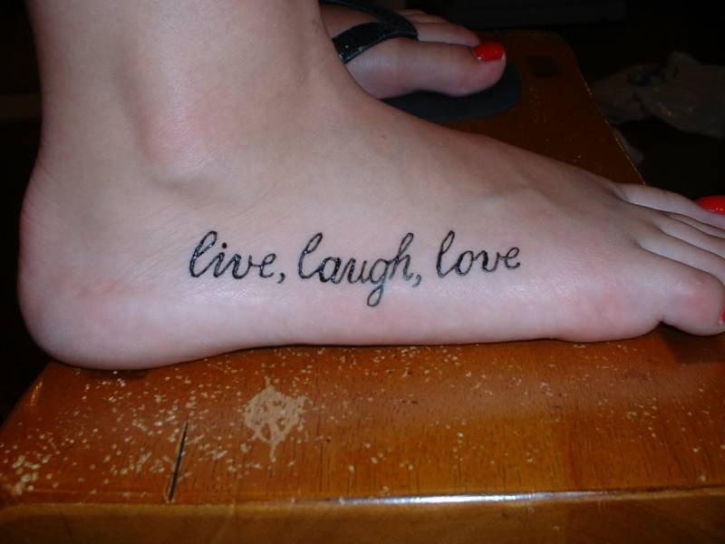 Simple Live Laugh Love Tattoo On Foot