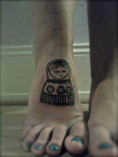 Simple Matryoshka Doll Tattoo On Foot
