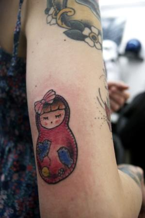 Small Matryoshka Tattoo On Back Arm