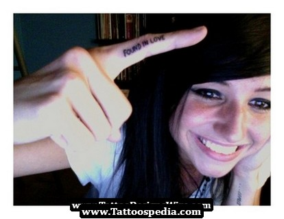 Smiling Girl With Love Finger Tattoo