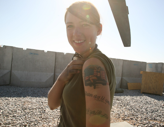 Smiling Girl With Military Tattoo On Arm