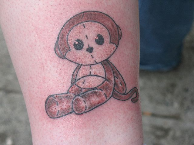 A Cute Monkey Tattoo On Leg
