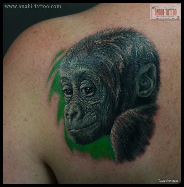 Baby Monkey Portrait Tattoo On Back Shoulder