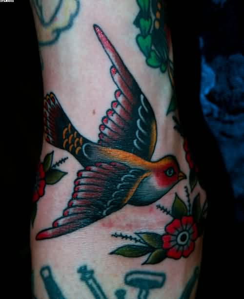 Beautiful Bird Tattoo With Flower On Arm