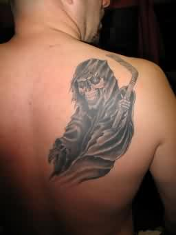 Black Ink Grim Reaper Tattoo On Back Shoulder