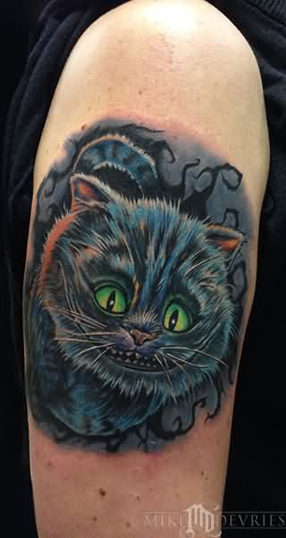 Cheshire Cat Tattoo On Biceps