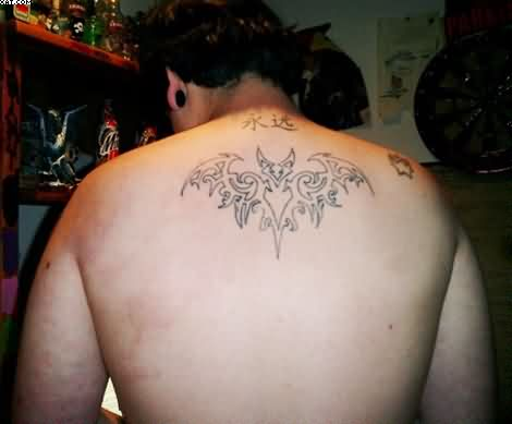 Cool Tribal Style Bat Tattoo On Upper Back