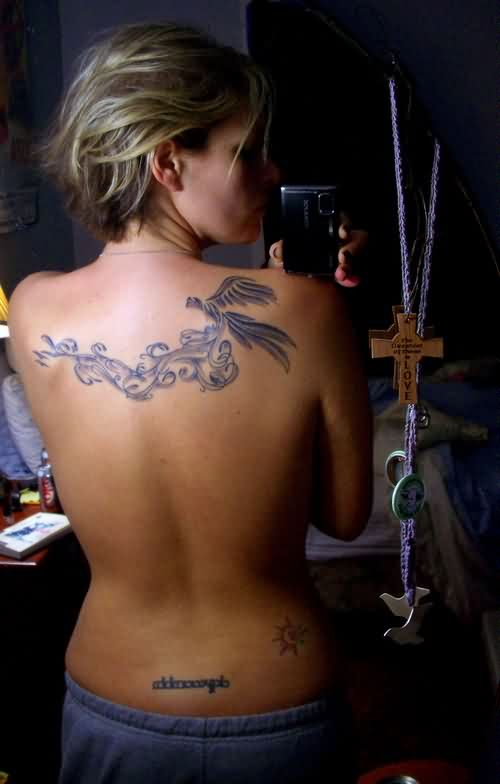 Sexy Feminine Tattoo On Upper Back