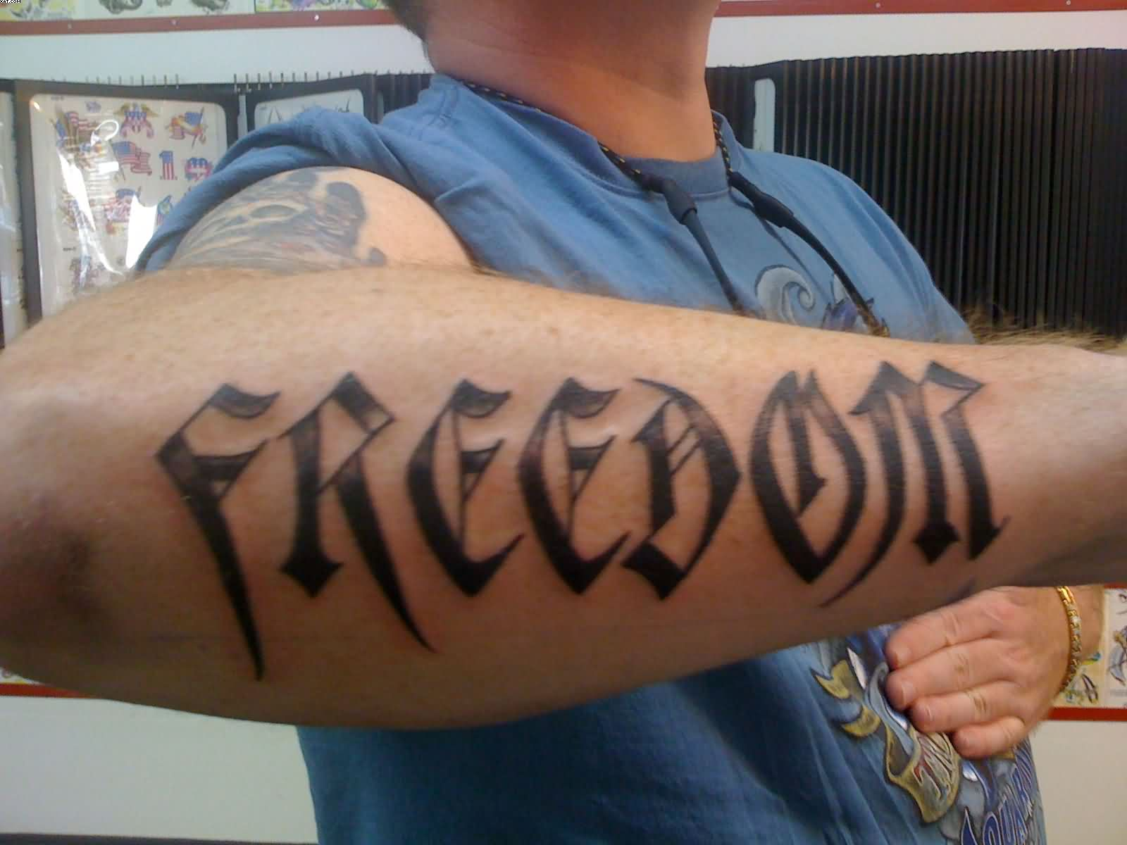 Freedom Word Arm Tattoo Design