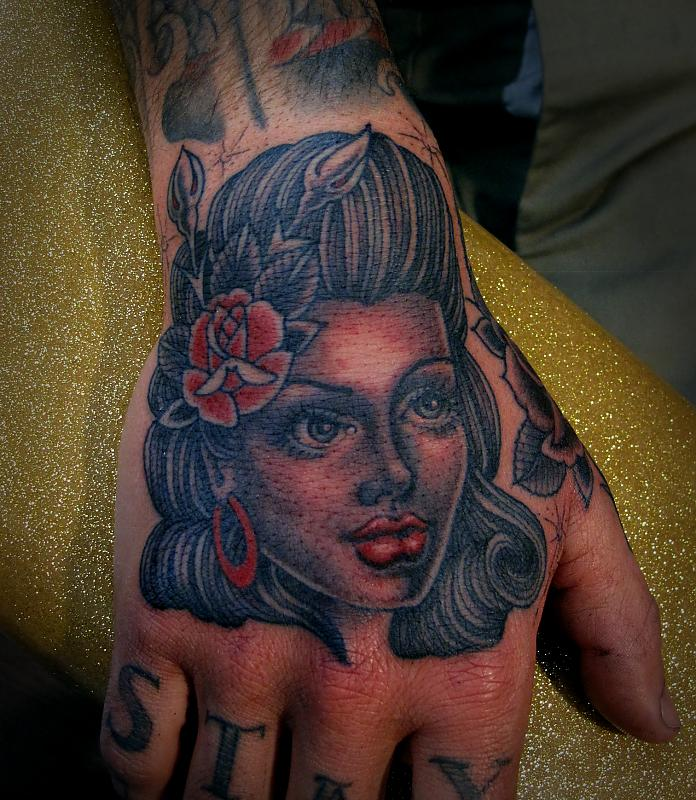 Girl Face Tattoo On Hand