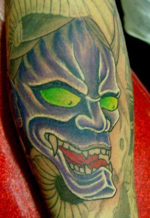 Green Eyed Devil Tattoo