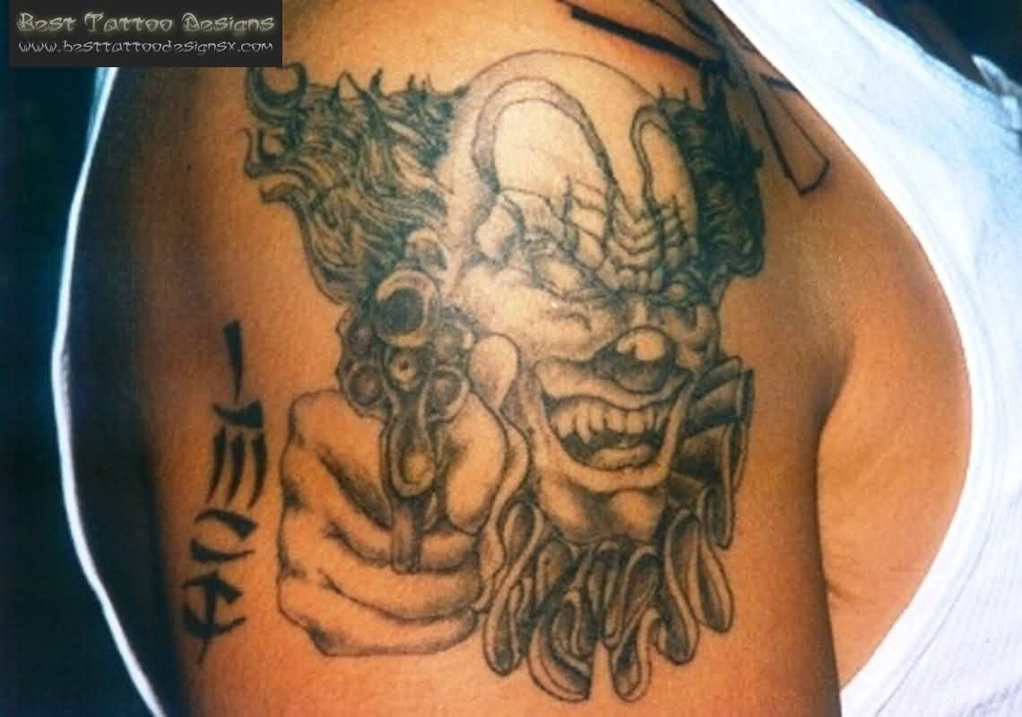 Grey Ink Gangsta Clown Tattoo On Shoulder