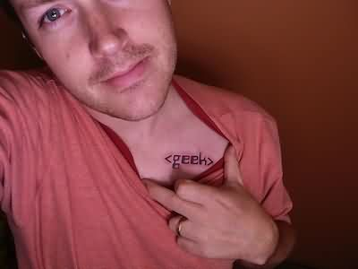 Guy Showing Geek Tattoo On Chest
