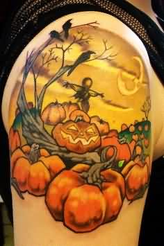 Halloween Pumpkin Tattoo On Right Shoulder