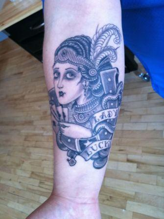 Lady Luck Gambling Tattoo On Lower Arm