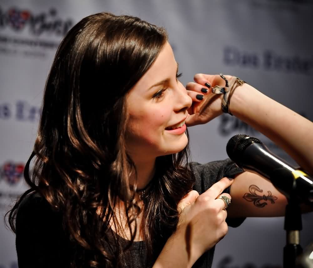 Lena Meyer Landrut Fleur De Lis Tattoo On Biceps