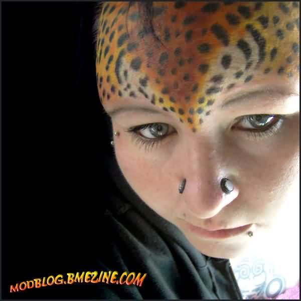 Leopard Skin Forehead Tattoo